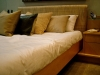 bed-with-lots-of-cushions_0